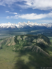 Approaching Jackson Hole airport (pattycphotography) Tags: blue sky clouds green trees mountains snow winter summer landscape rural flight