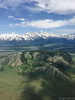 Approach to Jackson Hole (pattycphotography) Tags: jacksonholewyoming jacksonhole wyoming spring snowcappedmountains blue sky clouds green trees mountains snow winter summer landscape rural flight