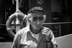 Puffing away (Frank Fullard) Tags: frankfullard fullard candid street portrait sailor smoker puff cigarette glasses crete greece island hania