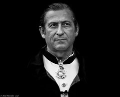 Aristocratic (Neil. Moralee) Tags: neilmoralee usa2017neilmoralee man cape portrait face medal pendant emblen french new orleans usa louisiana tradition aristocrat aristocratic aristocracy hair slick black white bw bandw blackandwhite mono monochrome collar dracula count duke earl knight knite mature stare costume ceremony ceremonial neil moralee nikon d7200 candid street