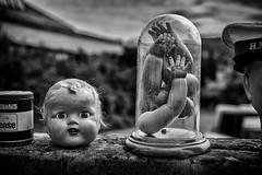 baby doll (Daz Smith) Tags: dazsmith fujixt20 fuji xt20 bath city streetphotography candid citylife thecity urban streets uk monochrome blancoynegro blackandwhite mono jar arms hands baby doll face head hat scary