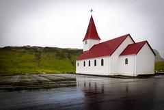Víkurkirkja II (Jack Landau) Tags: víkurkirkja vik church iceland hills mountains mist fog rain grass flowers landscape nature jack landau