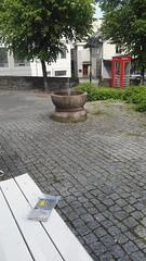 Book on a bench. (zimort) Tags: bok book bookcrossing gjøvik norge fontene telefonkiosk wildrelease benk bench