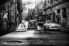 Central Havana (I saw_that) Tags: cuban classic cars street blackandwhite road backlit evening highlights havana habana intersection traffic side streetphotography noir hss post processing vivid surreal hdr sharp sharpness clarity depth field dof f11 absoluteblackandwhite