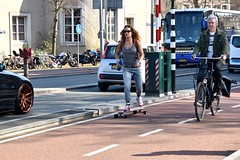 Amsterdam In Motion (FaceMePLS) Tags: amsterdam nederland thenetherlands facemepls nikond5500 straatfotografie streetphotography fiets fietser bicycle rijwiel tweewieler skatboard skater girl bidon transportfiets