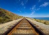 Heading South (buddythunder) Tags: usa travel california ca wideangle pacific coast highway railroad tracks railway rust leadin rails blue summer clear warm contrast sleepers symmetry balance