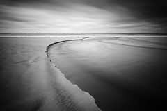 Beach Erosion (annemcgr) Tags: beach sand water clouds shadows lelongexposure monochrome blackwhite fineartphotography annemcgrath