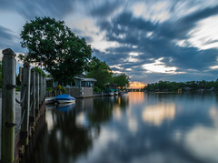 Slow St. Joe (tquist24) Tags: elkhart hff indiana nikon nikond5300 outdoor stjosephriver boat clouds evening fence geotagged longexposure reflection reflections river sky sunset tree trees water unitedstates