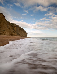 Greater Than (Sarah_Brooks) Tags: seascape le longexposure shore cliff jurassiccoast dorset sky clouds summer inversion