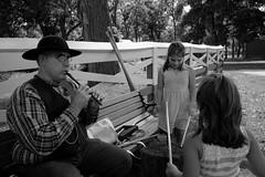 Family Fun, Kline Creek Farm. 23 (X70) (Mega-Magpie) Tags: fuji fujifilm x70 kline creek farm west chicago dupage il illinois usa america people person man girl music hat fence bw black white mono monochrome outdoors