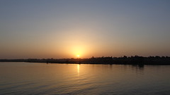 Nile Sunset (Rckr88) Tags: nile sunset nilesunset nileriverupperegypt nileriver upperegypt river upper egypt africa africansunset travel travelling sun sunlight water waves wave reflection reflections reflectionsofthenile rivers riverbank thenileriver nature outdoors