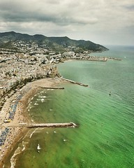 "(#droneview) | #Sitges is a coastal town in #Spain's Catalonia region, southwest of #Barcelona, backed by the mountainous Parc Natural del Garraf. It's known for its #Mediterranean beaches and seafront promenade lined with grand mansions. The compact old (""guerrilla"" strategy) Tags: ifttt instagram droneview 