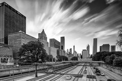 Chicago on fire...... (Kevin Povenz Thanks for the 3,300,000 views) Tags: 2017 july chicago illinios kevinpovenz midwest street streetphotography downtown blackandwhite bw canon7dmarkii sigma1020 city cityscape train tracks buildings building skyscrapers evening eveningsky sunset sky clouds longexposure