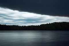 Beware of the Darkness (matthewkaz) Tags: sky clouds cloud darkclouds storm weather zigzaglake lake water wildernessnorth fishcamp fishing zigzag trees silhouette borealforest longexposure reflection reflections ontario canada 2017 aspen aspentrees