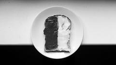 Half Half II (Konstantin Delbrück) Tags: bread cheese 169 pixelmator nutella chocolate plate circle bw noir thrid rule contrast
