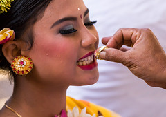 A teenage girl having her teeth blessed with a ring by a priest before a tooth filing ceremony, Bali island, Canggu, Indonesia (Eric Lafforgue) Tags: asia asian bali bali2486 balinese beliefs canggu ceremony closeup clothing colorimage customs filing headshot hindu hinduism horizontal indigenouspeople indonesia indonesian indonesianculture manusa mesangih mouth oneperson onewomanonly outdoors realpeople religion religious ring rite riteofpassage rites ritual spiritual teeth tooth toothfiling tradition traveldestination women baliisland