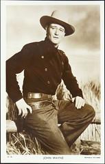"John Wayne as the ""Ringo Kid"" in the John Ford movie ""Stagecoach"" (1939). British Picturegoer Postcard  D-118, (ca. 1950s) (lhboudreau) Tags: johnwayne ringokid theringokid motionpicture movie star celebrity actor cowboy desperado gunslinger gunfighter gun holster sixgun cowboyhat johnfordsstagecoach stagecoach hollywoodstar hollywoodactor 1939 postcard postcards vintagepostcard pose posing d118 postcardd118 picturegoer picturegoerpostcard britishpostcard cowboyoutfit youngjohnwayne western classicwestern wayne"