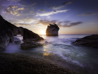 Sunrise from Baia dei Faraglioni.