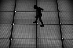 Boy (Eleni Maitou) Tags: boy nightshot streetphotography street streetlife nikon nikond90 nightlife inmotion blackandwhite bw blackwhite outdoors outside snfcc