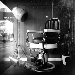 ( One haircut at a time ) (Wandering Dom) Tags: barber shop antique vintage chair street urban humans people existence time life reality dream roam wandering noiretblanc earth expression being nothingness hair dryer past present habits usa multiverse