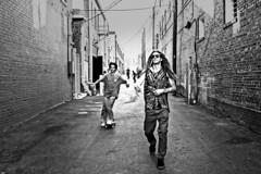 Alley BW:  Style #1 (brev99) Tags: tamron35f18vc d610 blackandwhite perfecteffects17 dude people alley bullinthealley brickwalls skateboarder vignette dxofilmpack5 ononesoftware on1photoraw2017