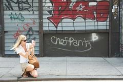 A woman taking a picture on Lafayette Street as seen during Summer Streets. (jackszwergoldarchives) Tags: manhattan newyorkcity summerstreets szwergold