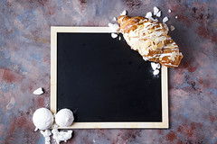 Croissant with meringue on chalkboard (lyule4ik) Tags: croissant breakfast bakery bread meringue background bun closeup pastry table continental food fresh macro meal morning roll butter french spice bake brown buttered buttery cafe color crust cuisine delicious dessert dough ear eat fat freshness gold golden grey object snack spike spikelets sweet tasty traditionally yummy juice