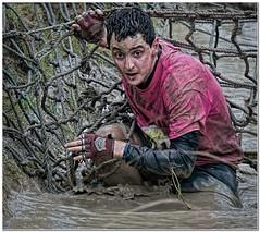 Mud runner (Hugh Stanton) Tags: mud net rope runner