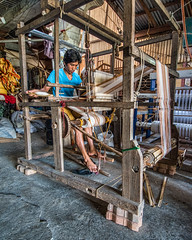 Loom Operator (FotoGrazio) Tags: filipino lostart man pacificislander philippines pinoy vigan waynegrazio waynesgrazio weaver art composition contraptions fabric fabricmaking feet fotograzio handmade humanancienttechnology humanoperated loom male manuallabor men people textiles weave weaving yarn