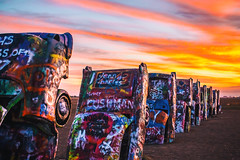 You Fall Hard (Thomas Hawk) Tags: amarillo america antfarm cadillac cadillacranch chiplord dougmichels hudsonmarquez route66 stanleymarsh stanleymarsh3 texas usa unitedstates unitedstatesofamerica auto automobile car graffiti sunrise us fav10 fav25 fav50 fav100