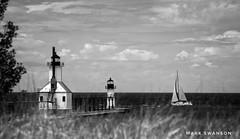 Almost Home (mswan777) Tags: lighthouse pier sailboat sail lake michigan river grass beach dune seascape water wind shore outdoor sky cloud st joseph monochrome black white