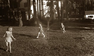 Playing in the sprinklers, c. 1954