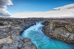 Godafoss Outflow (Herculeus.) Tags: 2017 april bouldersstonerocks bridges cliffs clouds country day erosion europe godafossiceland gorge hills ice iceland landscape landscapes mountains outdoor outdoors outside rapids river skjalfandafljoticeland spring water waterfalls sightseers tourists