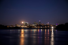 Full Moon Over the City Wide Angle - EXPLORED (KC Mike D.) Tags: moon full city skyline downtown point kaw kawpoint kansasriver missouririver river kansascity missouri photography evening dusk night reflection reflections water glow illuminate visitkc