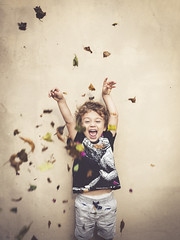 Total hapiness. (Pablin79) Tags: portrait boy people outdoor leaf child colors happy music fun wall funny childhood one action argentina wear misiones facialexpression vini posadas