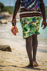 The sound of the sea (Fran Caparros) Tags: baru colombia playa beach sand arena blanca white sea mar transparentee hombre man joven young seashell caracol vida marina sudamerica america latinoamerica latinamerica cartagena de indias bolivar aire air pure