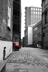 Angry Beemer (fanmickeywang) Tags: building street city urban pavement red brick car selectivecolouring selectivecoloring
