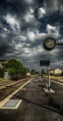 Trop tôt ou trop tard ? (Fred&rique) Tags: lumixfz1000 photoshop raw hdr champagnole jura gare matin voiex trains marchandises quais ciel orage nuages heure horloge désert bancs