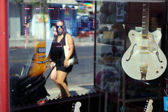 Guitar Shop (Ivona & Eli) Tags: urban street summer israel telaviv human neon color reflection window vitrine guitar shop