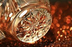 Falling Star (Through Serena's Lens) Tags: hmm macromondays bottomsup macro glassware star crystal glass bottom milkjar bokeh dof glitterpaper brown pattern 7dwf pov