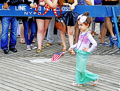 American (kirstiecat) Tags: american america mermaid coneyisland nyc newyorkcity impeachtrump trumpmustgo 25thamendment girl female child kid parade costume street canon life sad independenceday ezraklein vox diminishedamerica dissentispatriotic urban city politics progressive
