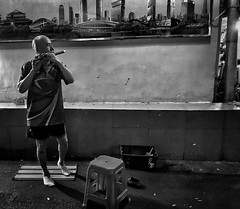 Dancing with his flute . (-Faisal Aljunied - !!) Tags: busker streetperformer streetlife blackandwhitestreet streetphotography flute china guangzhou iphone7plus faisalaljunied blowjob