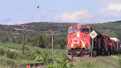 CN M30511-10 West through Cyr St. in Baker Brook, NB (MaineTrainChaser) Tags: 71017 cn nb qc trains train west westbound pelletier subdivision canada
