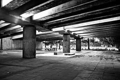 Under the Eastway (I M Roberts) Tags: undertheeastway pillars tabletennis urbansetting mableygreen lowerclapton hackneywick hackney eastlondon fujix100s bw