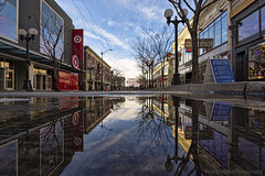 Puddle Reflection of Pike Street (Paul Scearce) Tags: puddle puddlereflection seattle washington washingtonstate reflection street mirror pikeplacemarket downtown clouds