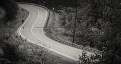 Walking Along Route Two (michael.mckennedy) Tags: road street jonesville vermont person curve blackandwhite