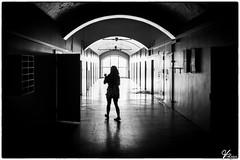 Prison Shadows (ViTaRu) Tags: canon 5dmk2 1635mmf28l prison kakola abandoned correctionalfacility hallway window light shadows contrast black mood woman dark building cells doors varsinaissuomi turku finland