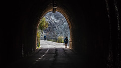 Light at the end of the tunnel (PhredKH) Tags: bonosola lavanto italy italiancoast italiantown italianriviera italia italiancoastaltown tunnel light outdoorphotography outdoor people pedestrians endofthetunnel photosbyphredkh fredkh phredkh arch gate
