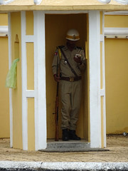 On Guard? (enjosmith) Tags: guard phnom penh royal palace mobile phone cell yellow white