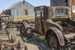 Boneyard (magnetic_red) Tags: rusted rust decay old vintage car barn building outdoors scrap junk noperson bluesky summer desert boneyard junkyard